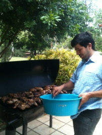 Luis cooking Sunday Lunch in Oscar's Asado